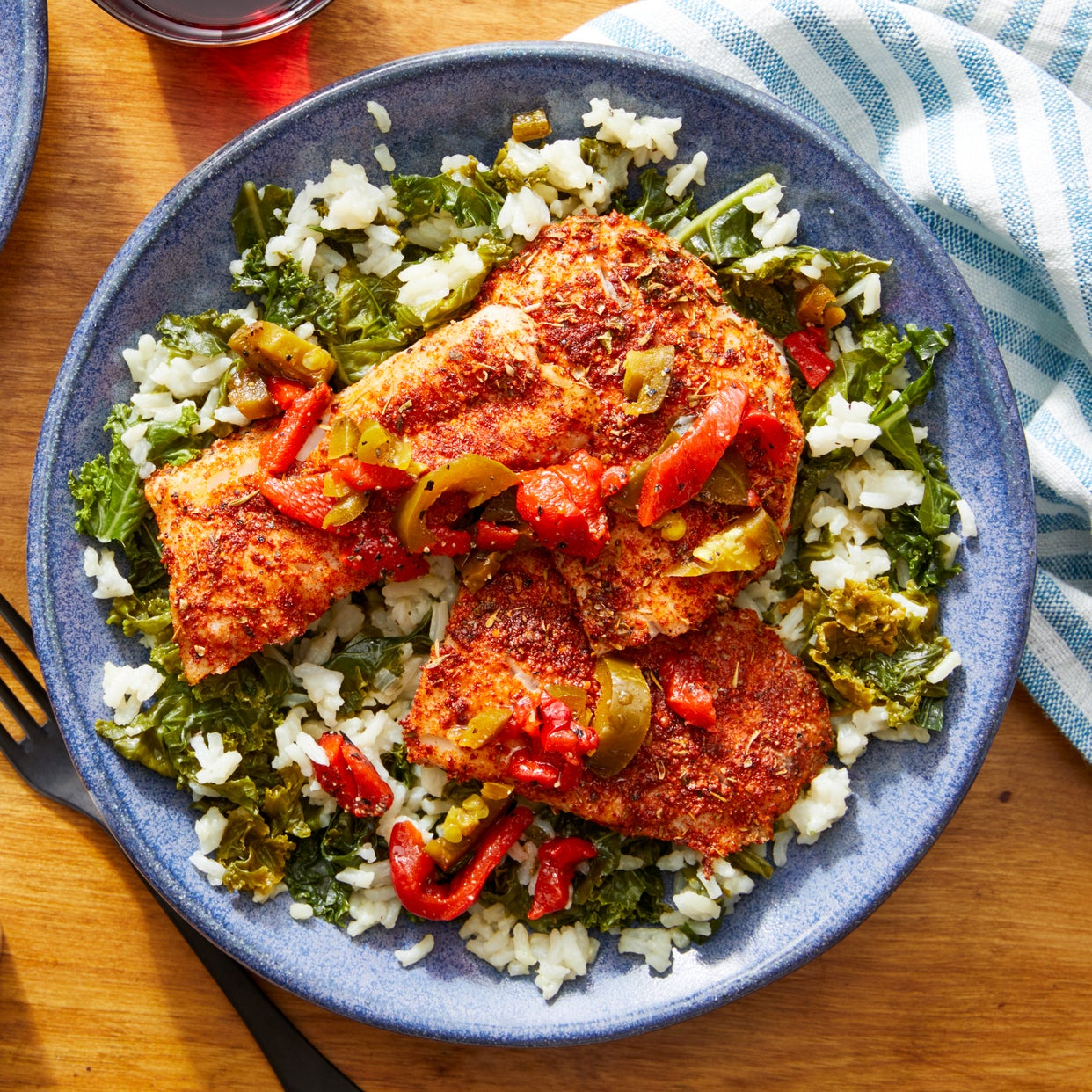 Cajun-Spiced Fish with Kale Rice & Pepper Topping