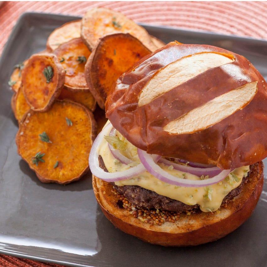Pretzel Burgers with Hoppy Cheddar Sauce & Roasted Sweet Potato Rounds