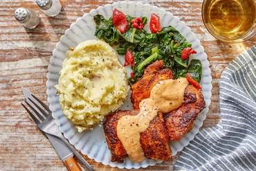 Spanish-Spiced Chicken Thighs & Aioli with Mashed Potatoes & Collard Greens