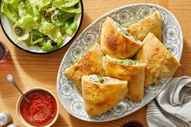 Cheesy Vegetable Calzones with Tomato Dipping Sauce & Caesar Salad