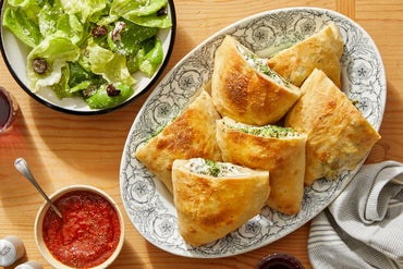 Cheesy Broccoli Calzones with Tomato Dipping Sauce & Caesar Salad