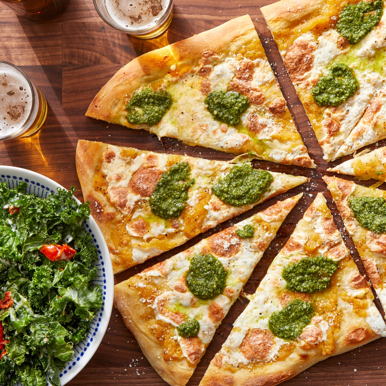 Yellow Tomato & Basil Pesto Pizza with Kale Caesar Salad