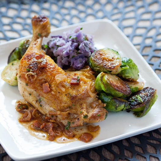 Pan-Seared Chicken Legs  with Purple Potatoes, Brussels Sprouts & Bacon Vinaigrette
