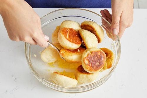 Finish the garlic rolls & serve your dish: