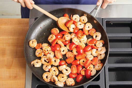 Cook the shrimp & tomatoes: