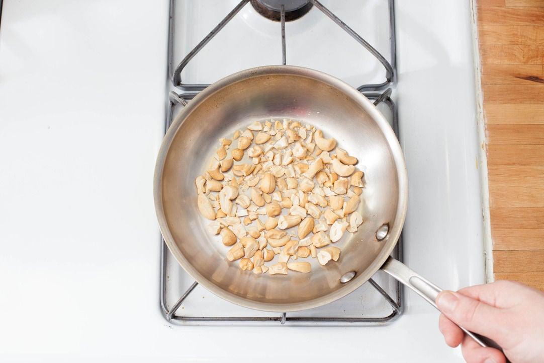 Toast the cashews: