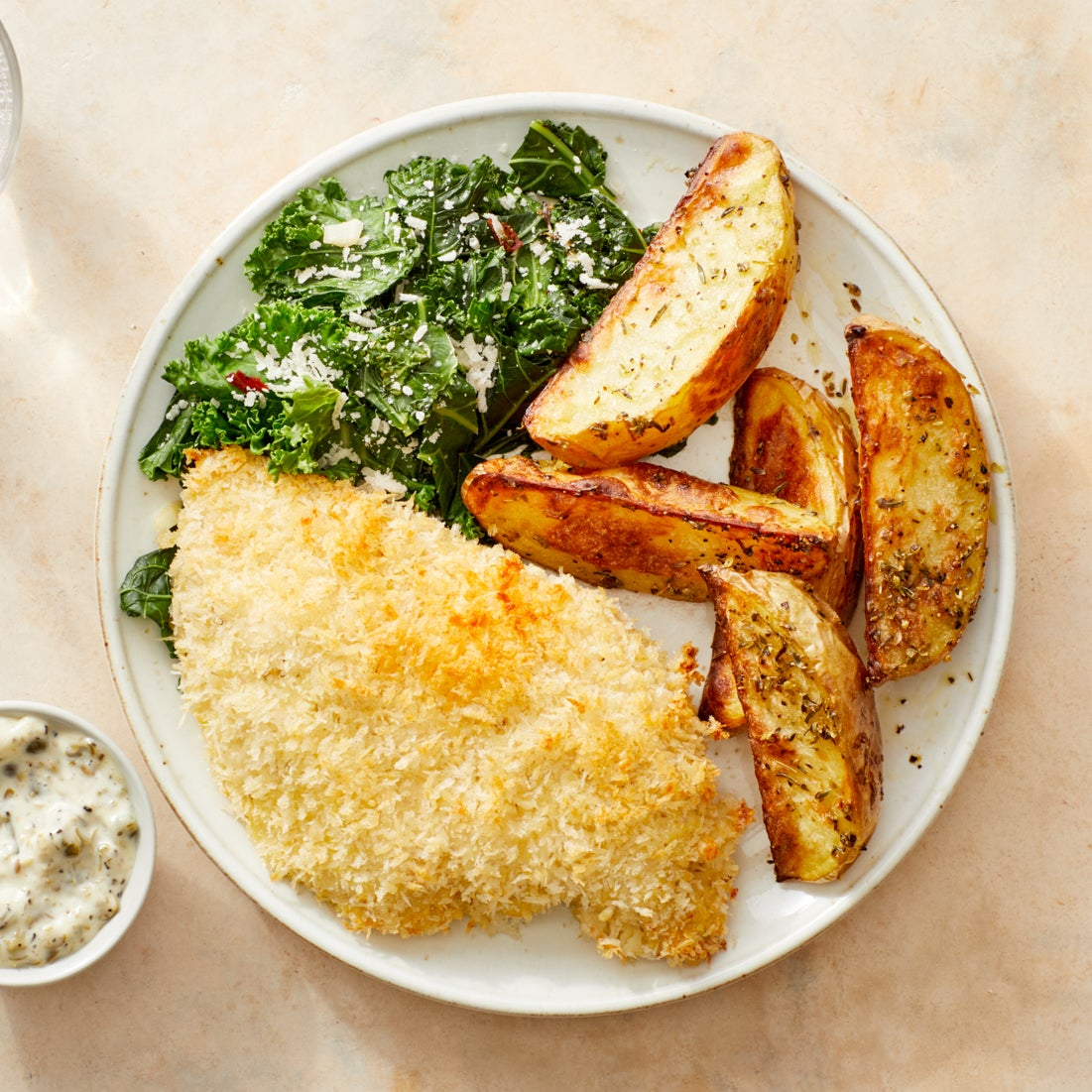 Crispy Baked Chicken with Sautéed Kale, Roasted Potatoes, & Caper Mayo