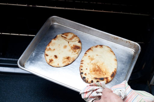 Toast the naan bread: