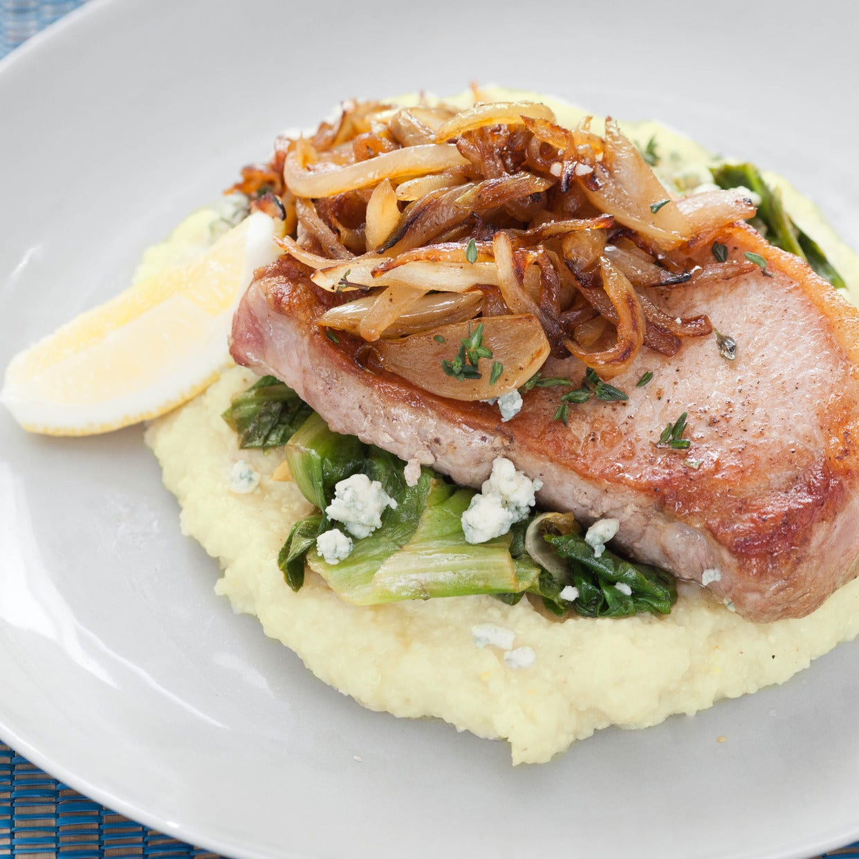Center-Cut Pork Chops with Caramelized Onions & Blue Cheese Grits