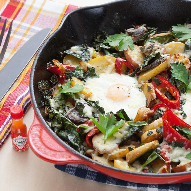 Fingerling Potato & Kale Hash with Baked Eggs & Aged Cheddar Cheese