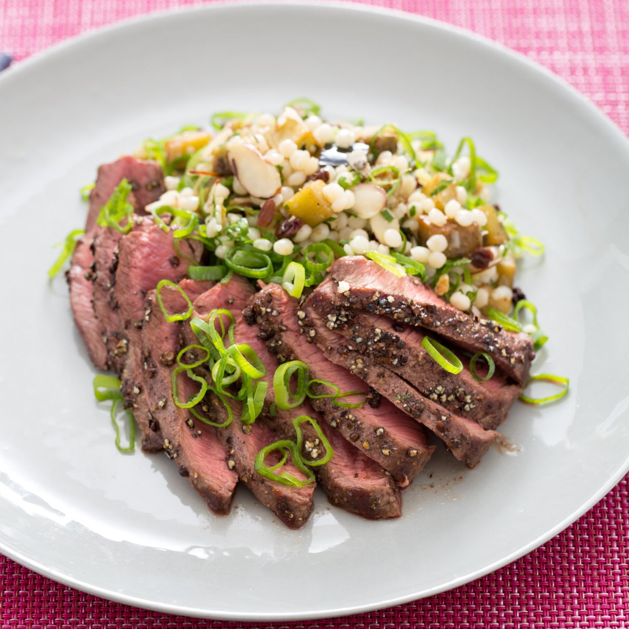 Grains of Paradise-Crusted Steak with Preserved Lemon, Eggplant & Israeli Couscous Salad