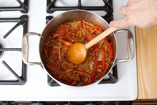 Start the piperade: