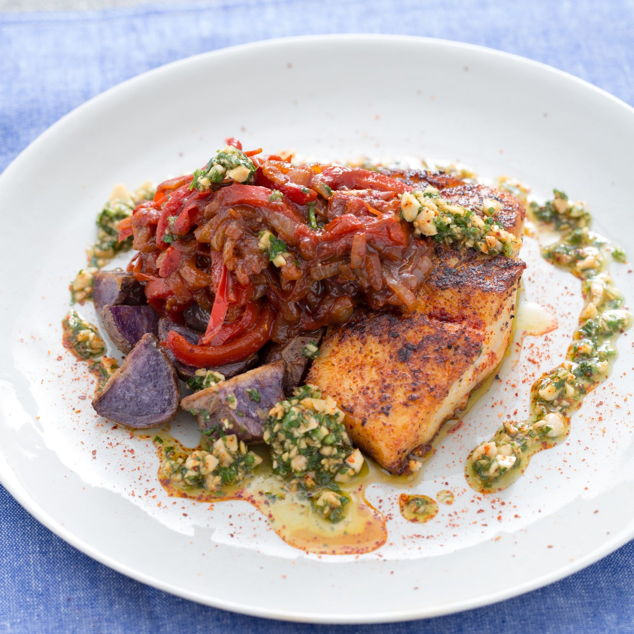 Seared Cod Piperade with Roasted Blue Potatoes & Parsley-Almond Sauce
