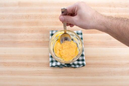 Make the achiote-crema sauce:
