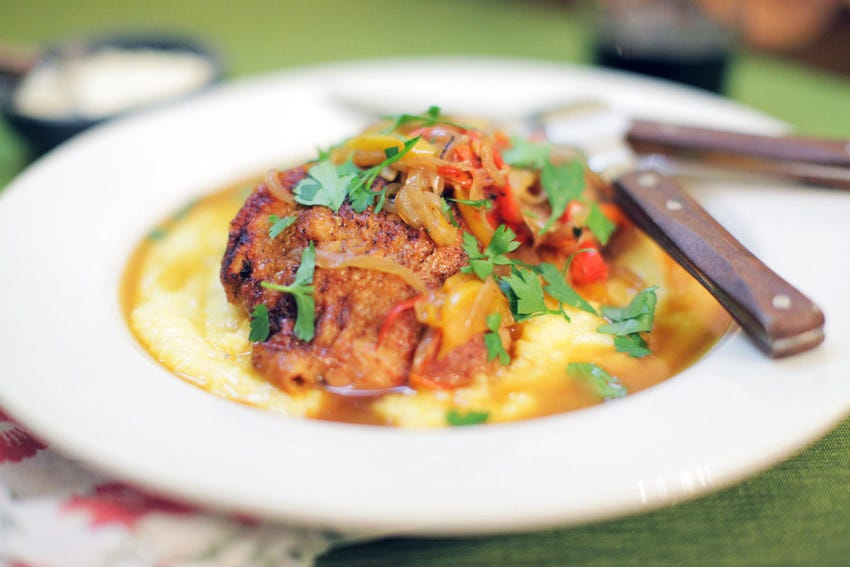 Braised Chicken Thighs with Caramelized Peppers & Onion over Creamy Polenta