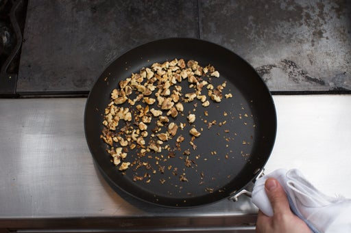 Toast the walnuts: