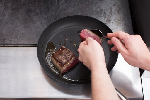 Cook & baste the steaks: