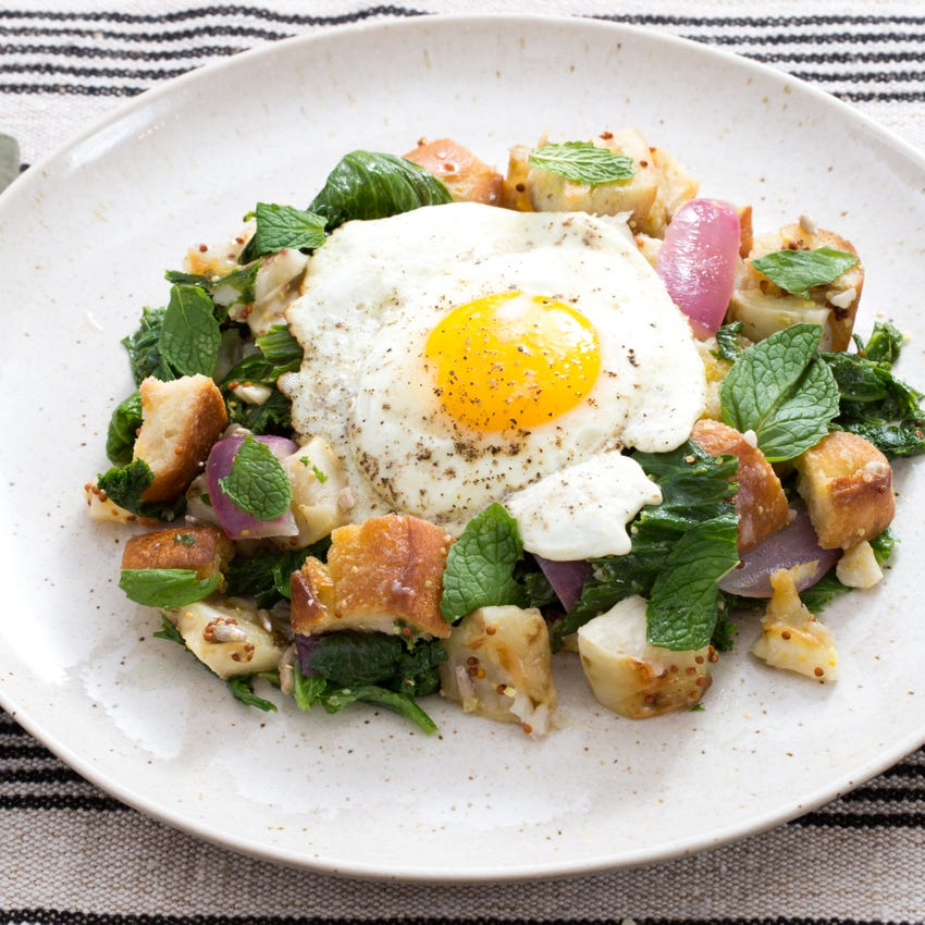 Warm Sunchoke & Mustard Green Salad with Fried Eggs, Pecorino Cheese & Homemade Croutons
