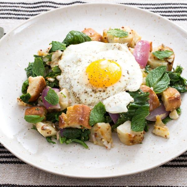 Warm Sunchoke & Mustard Green Salad with Fried Eggs, Pecorino Cheese & Homemade Croutons
