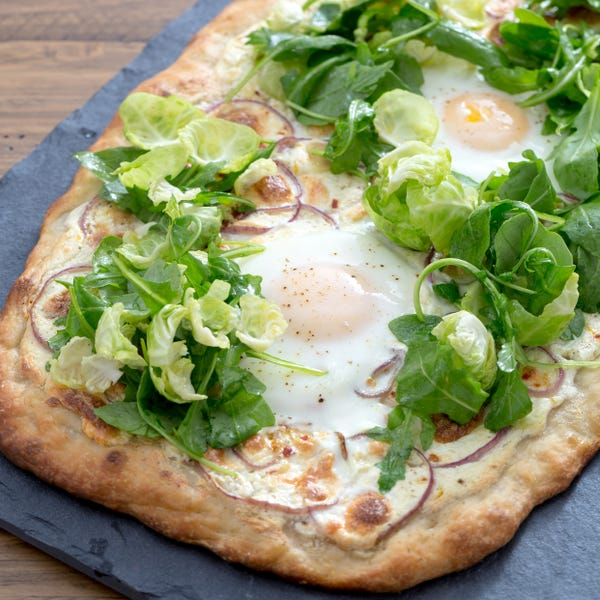 White Pizza with Baked Eggs & Arugula-Brussels Sprout Salad