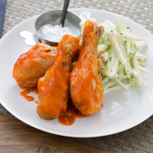 Buffalo-Style Chicken Drumsticks with Blue Cheese Sauce & Celery-Apple Salad
