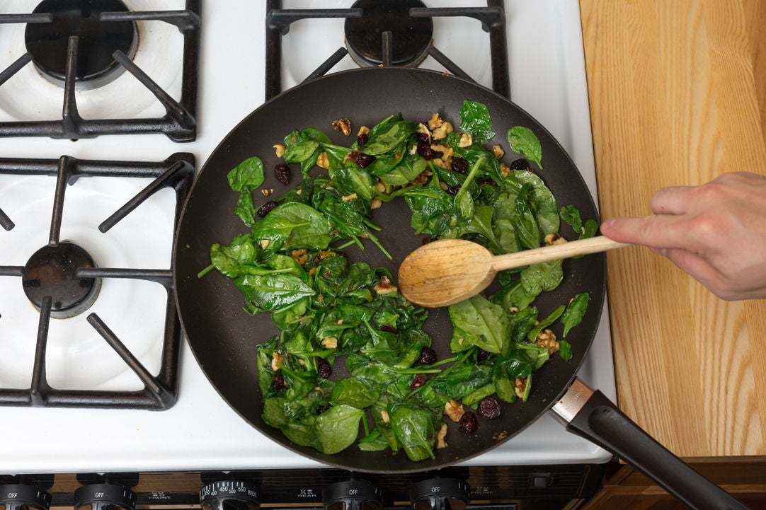 Cook the spinach & serve your dish: