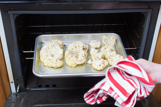 Roast the cauliflower steaks: