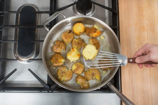 Brown the smashed potatoes:
