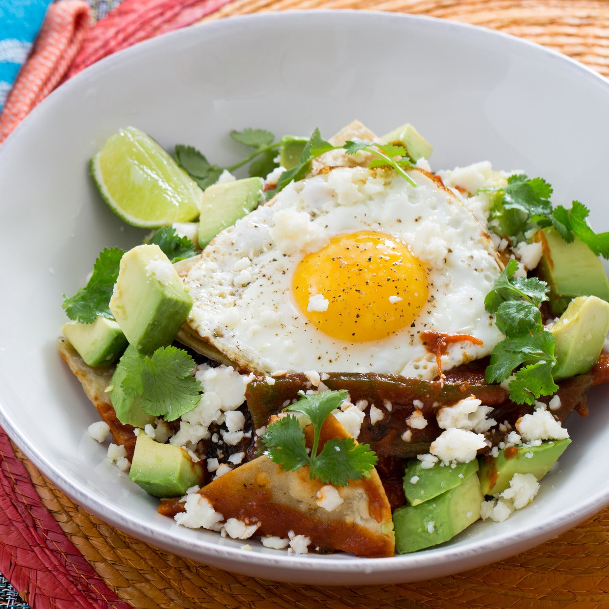 Roasted Poblano Chilaquiles with Sunny Side-Up Eggs & Avocado