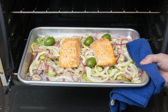 Roast the salmon, onion, fennel & olives: