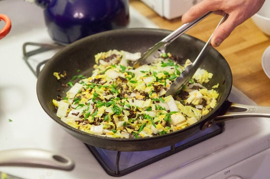 Cook the cabbage and add the rice: